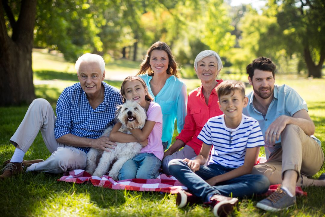 Portrait of happy family enjoying in park on sunny a day Free Stock Images from PikWizard