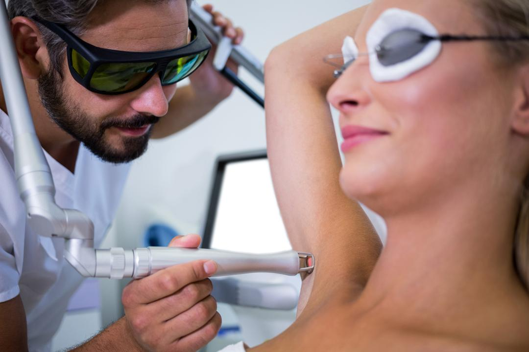 Dermatologist removing hair of patient armpit in beauty saloon Free Stock Images from PikWizard
