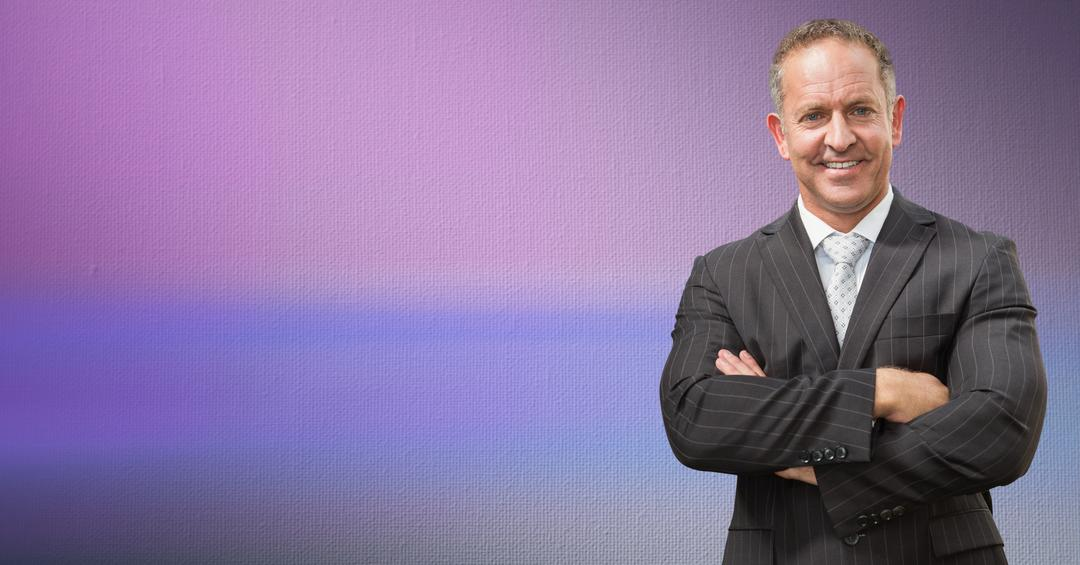 Portrait of businessman standing with arms crossed against colored background Free Stock Images from PikWizard