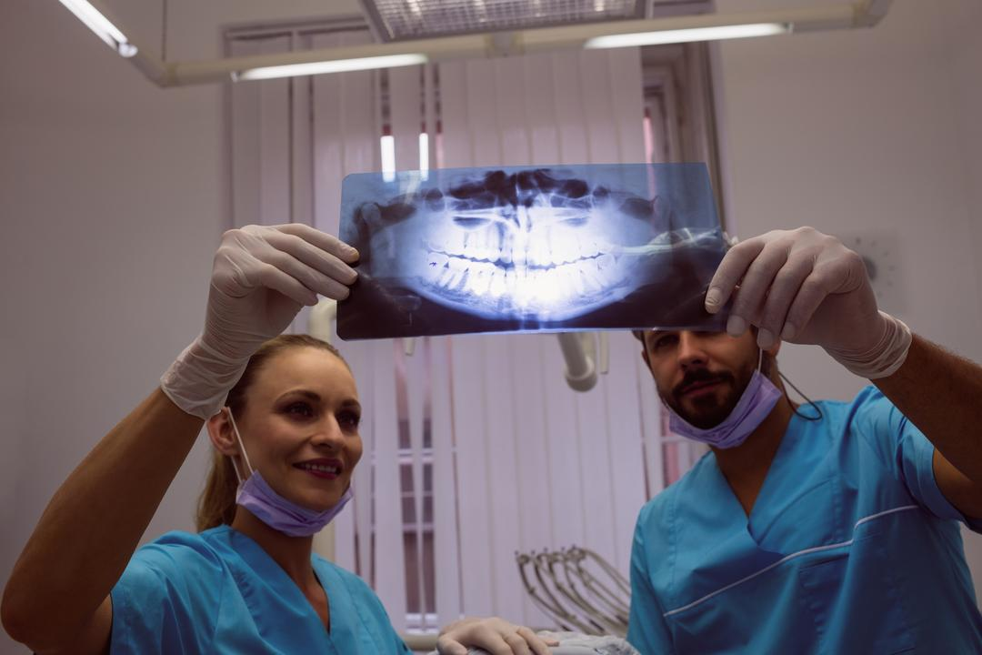 Dentists discussing over an x-ray at dental clinic
