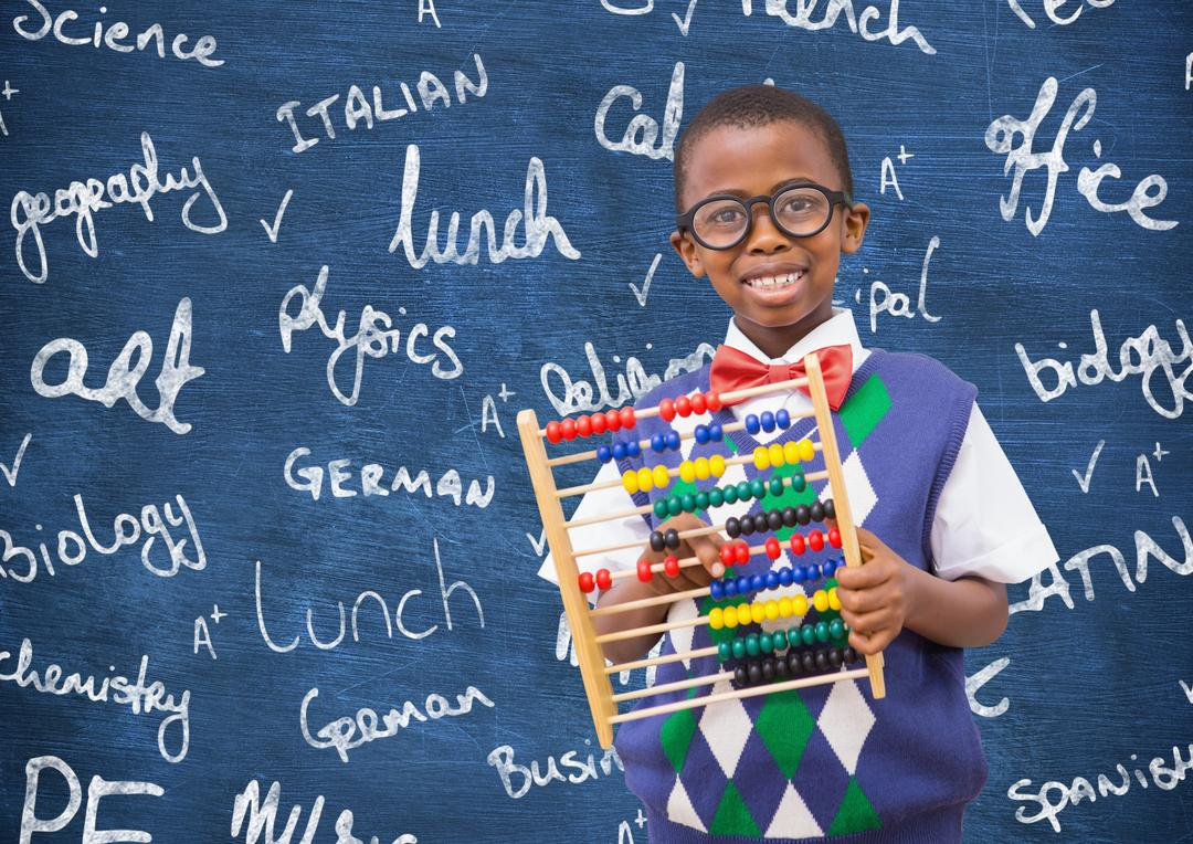 Digital composite image of intelligent schoolboy holding abacus against chalkboard Free Stock Images from PikWizard
