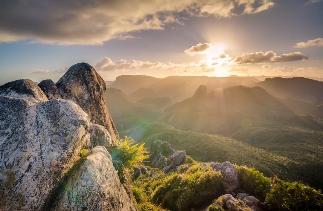 Landscape image of mountains with the sun shining in the background