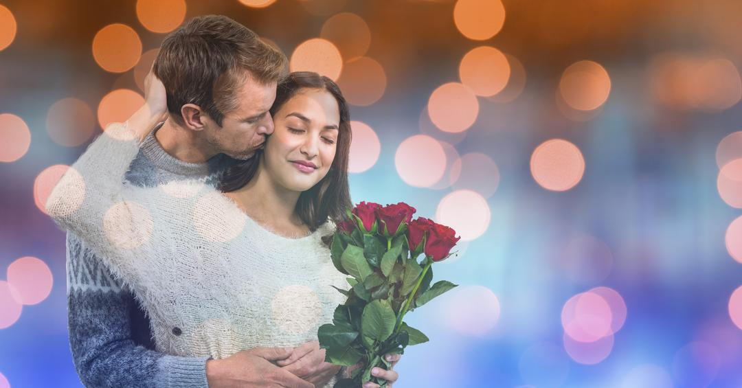 Digital composite of Loving man kissing woman holding roses over bokeh