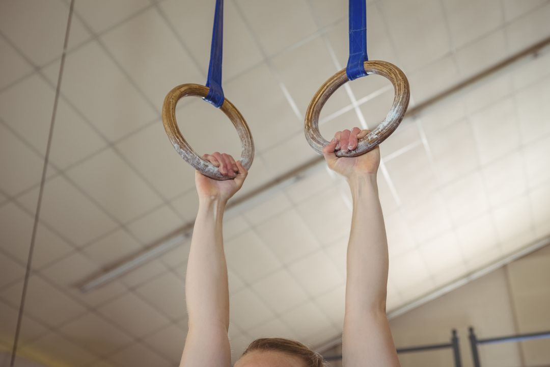 Close-up of a female gymnast practicing gymnastics on rings Free Stock Images from PikWizard