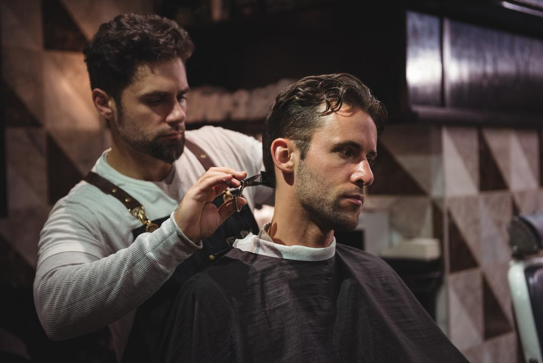 Man getting his hair trimmed with scissor in barber shop Free Stock Images from PikWizard