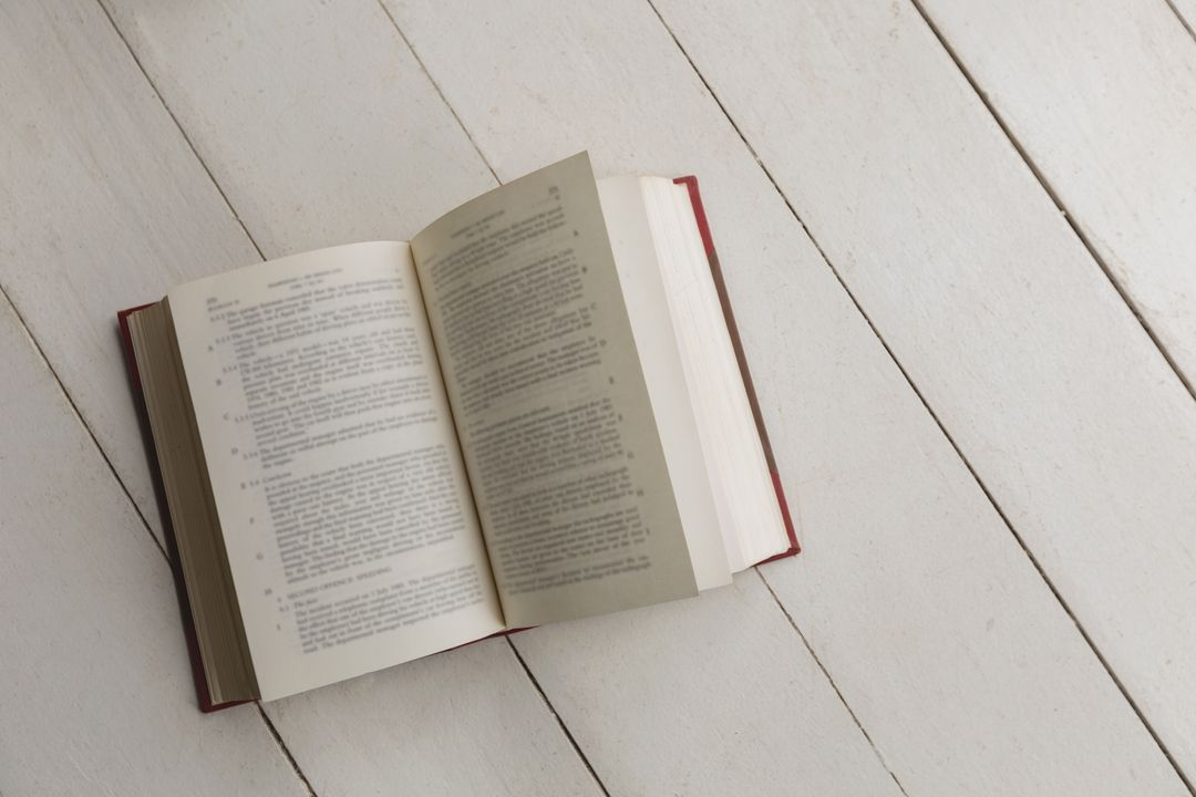 Image of an Open Book on a Table