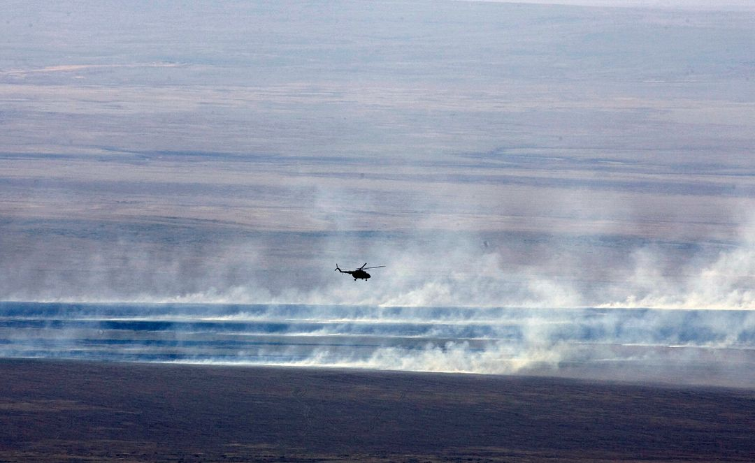 A Russian search and rescue helicopter flies over the burning Kazakh steppe after Expedition 16 Commander Peggy Whitson, Flight Engineer and Soyuz Commander Yuri Malenchenko and South Korean spaceflight participant So-yeon Yi landed their Soyuz TMA-11 spacecraft, Friday, April 19, 2008, in central Kazakhstan to complete 192 days in space for Whitson and Malenchenko and 11 days in orbit for Yi.  Photo Credit: (NASA/Reuters/Pool)
