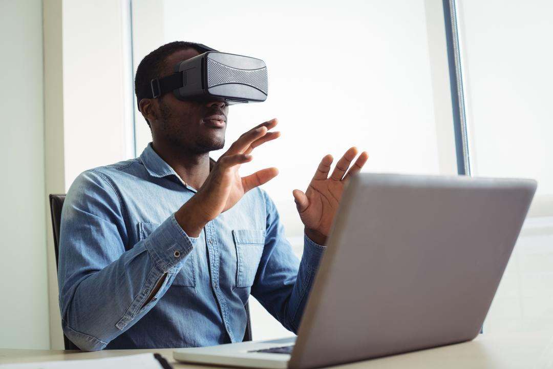 Business executive using virtual reality headset in office