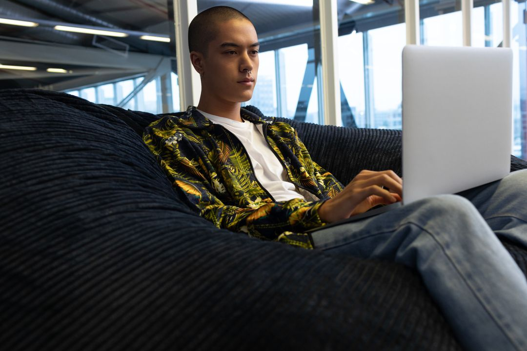 Young Businessman using laptop on a sofa in the office