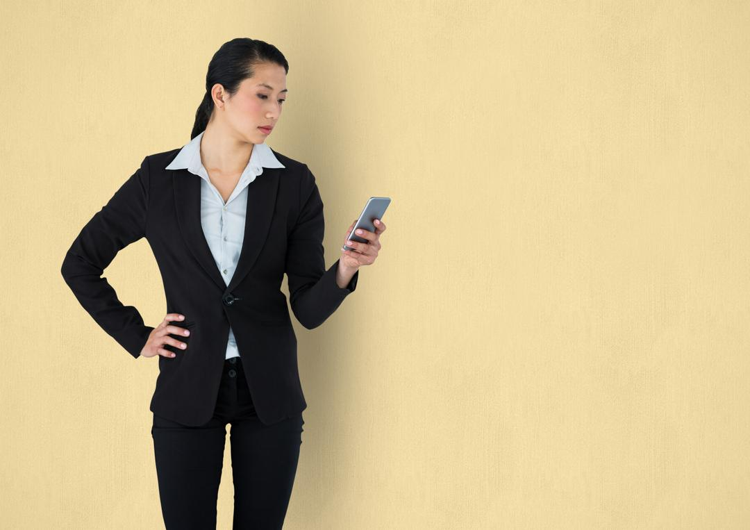 Digital composite of Businesswoman holding mobile phone over beige background Free Stock Images from PikWizard