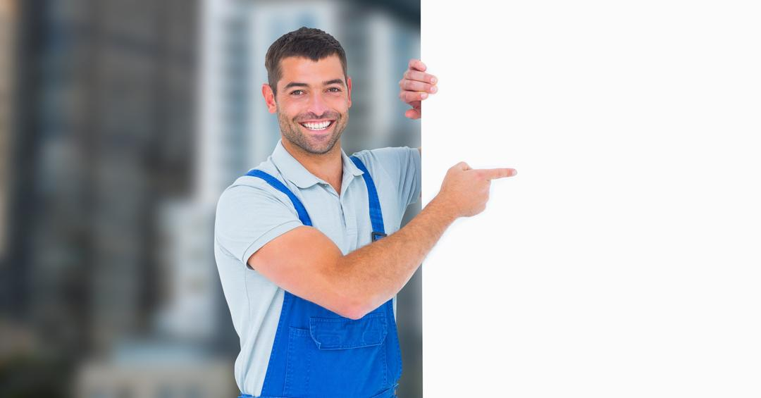 Digital composite of Worker pointing at blank bill board