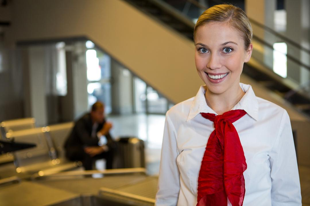 Portrait of smiling female staff at the airport terminal Free Stock Images from PikWizard