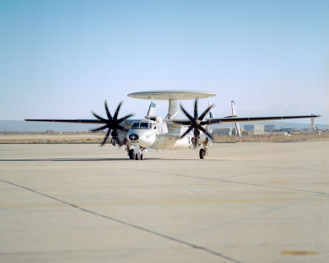 A Navy E-2C Hawkeye early-warning aircraft arrives at NASA's Dryden Flight Research Center for extensive structural loads tests in Dryden's flight loads lab.
