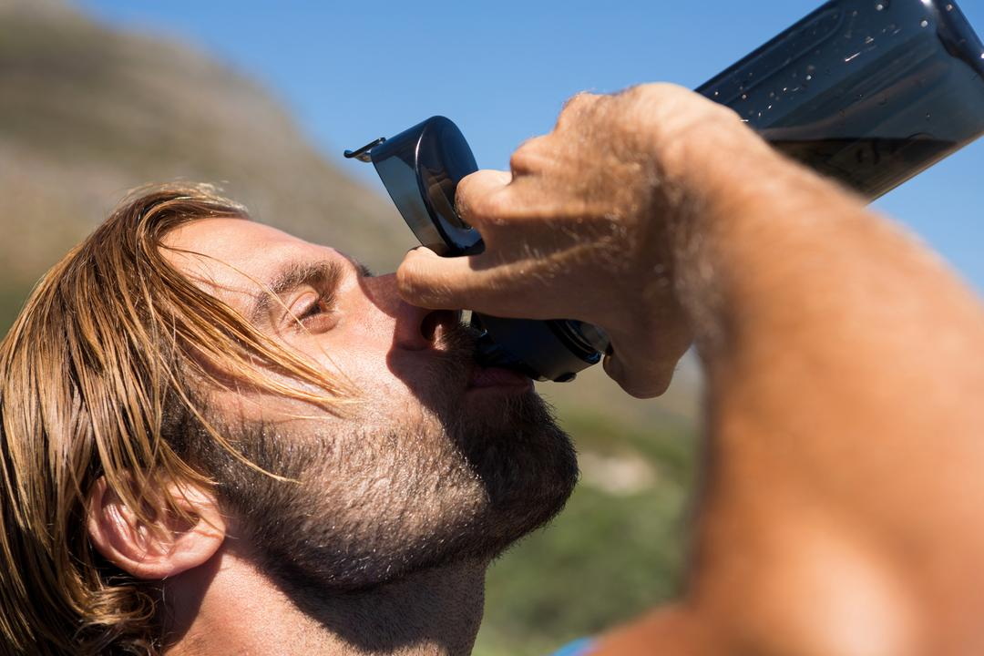 Close up of athlete drinking water from bottle Free Stock Images from PikWizard