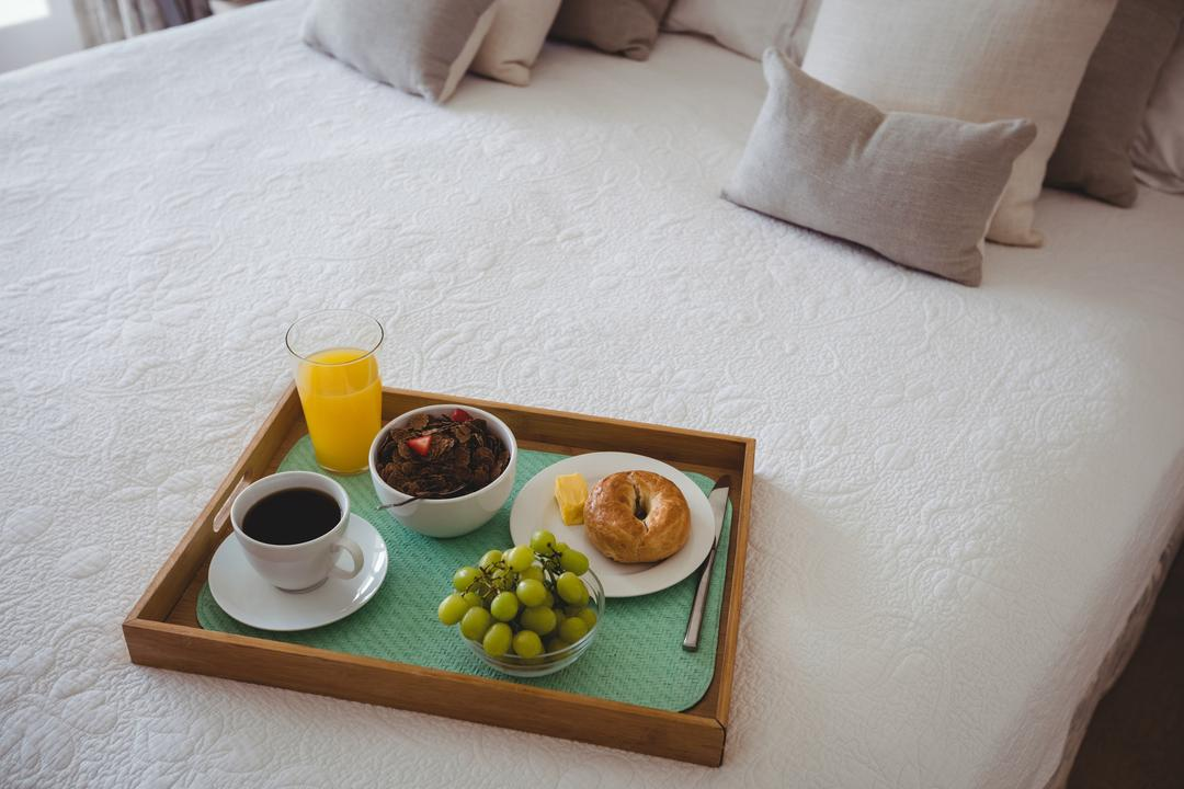 Breakfast tray on bed in bedroom at home