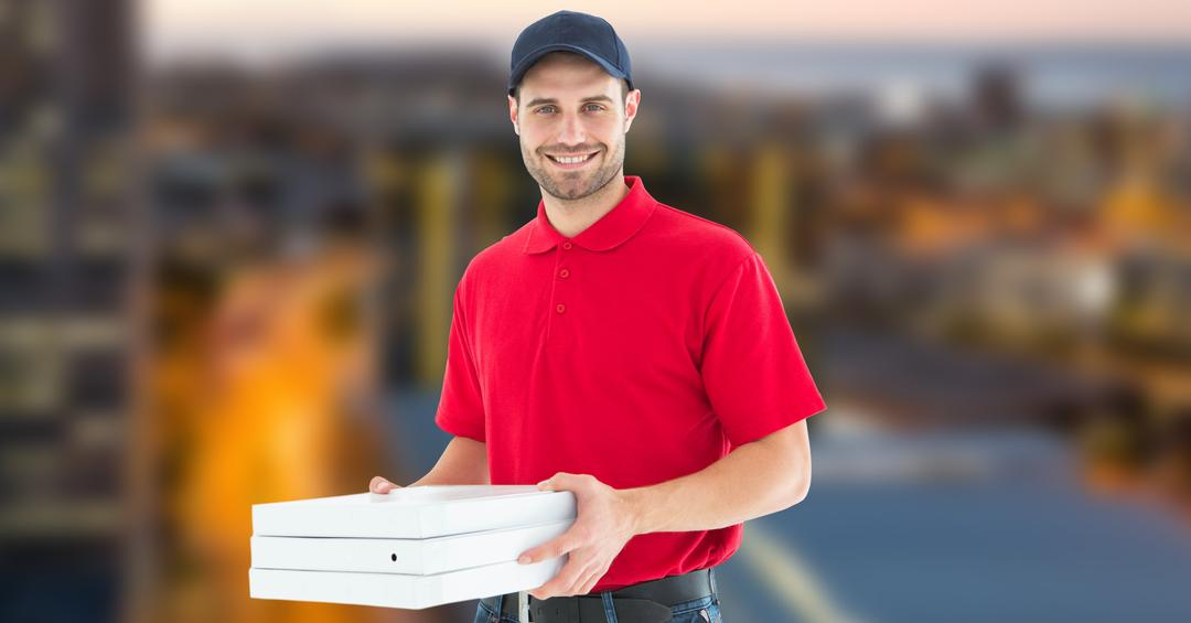 Digital composite of Delivery man holding pizza boxes