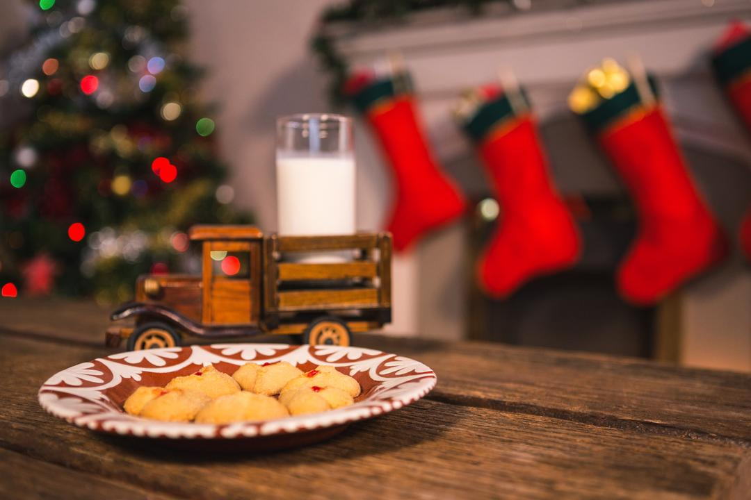 Christmas cookies on plate and toy truck with a glass of milk on wooden table during christmas time Free Stock Images from PikWizard