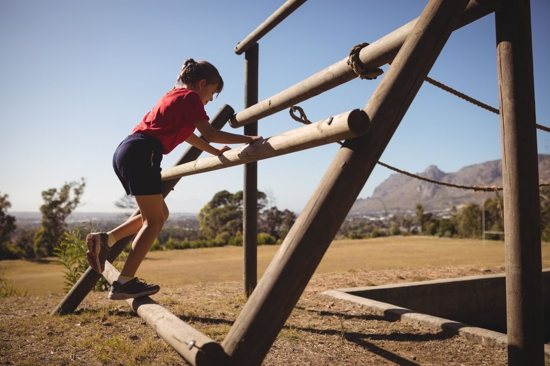 Girl exercising on outdoor equipment during obstacle course in boot camp Free Stock Images from PikWizard