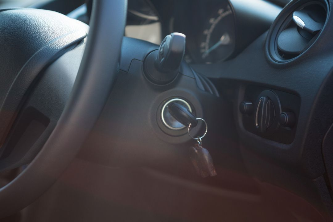 Close-up of car interior with steering wheel and key Free Stock Images from PikWizard