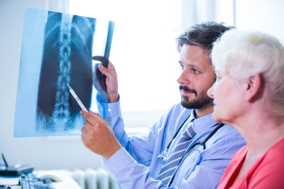 Doctor discussing x-ray with patient at the hospital