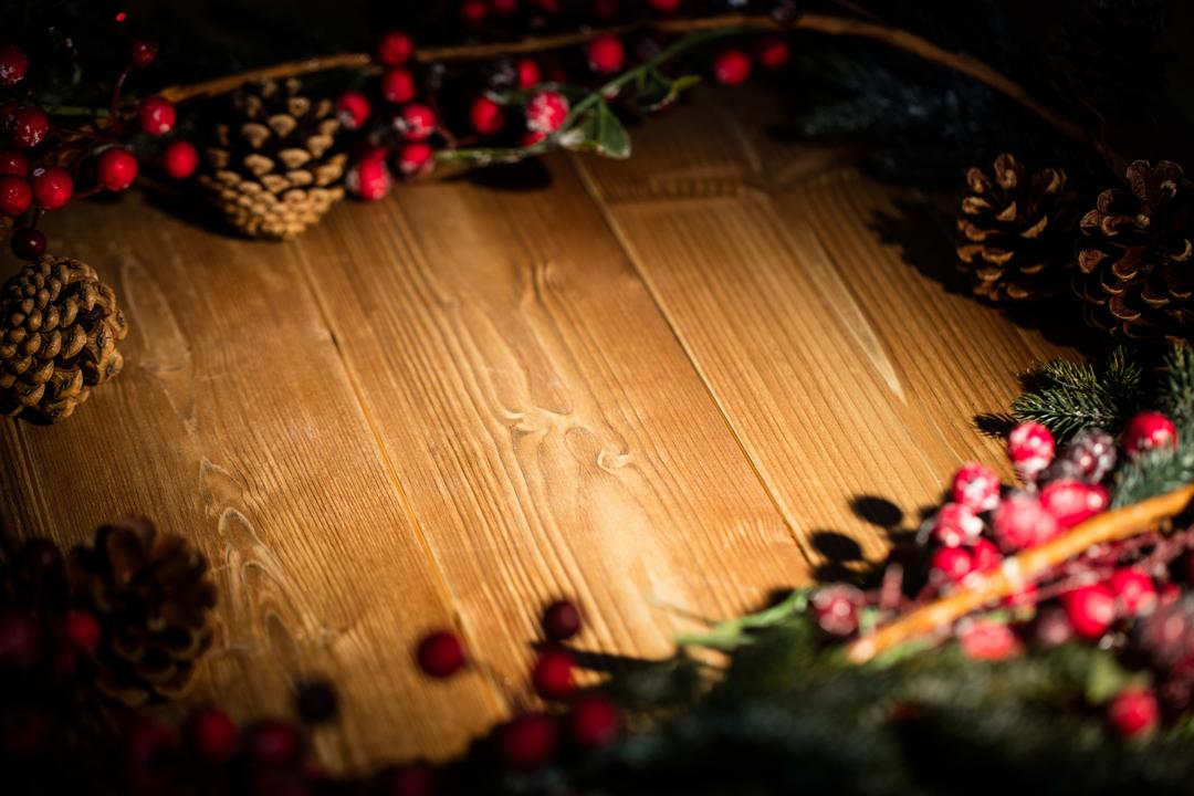 Christmas decorations on wooden plank during christmas time