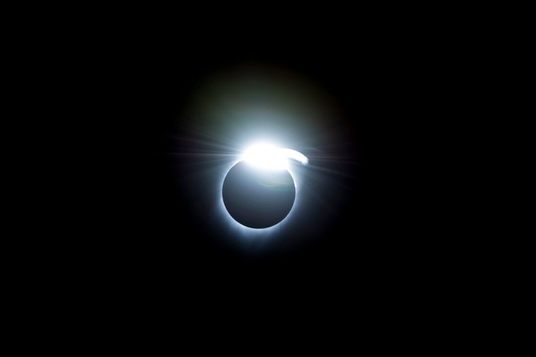 The diamond-ring effect occurred at the beginning and end of totality during a total solar eclipse. As the last bits of sunlight pass through the valleys on the moon's limb, and the faint corona around the sun is just becoming visible, it looks like a ring with glittering diamonds on it. Credit: (NASA/Carla Thomas)