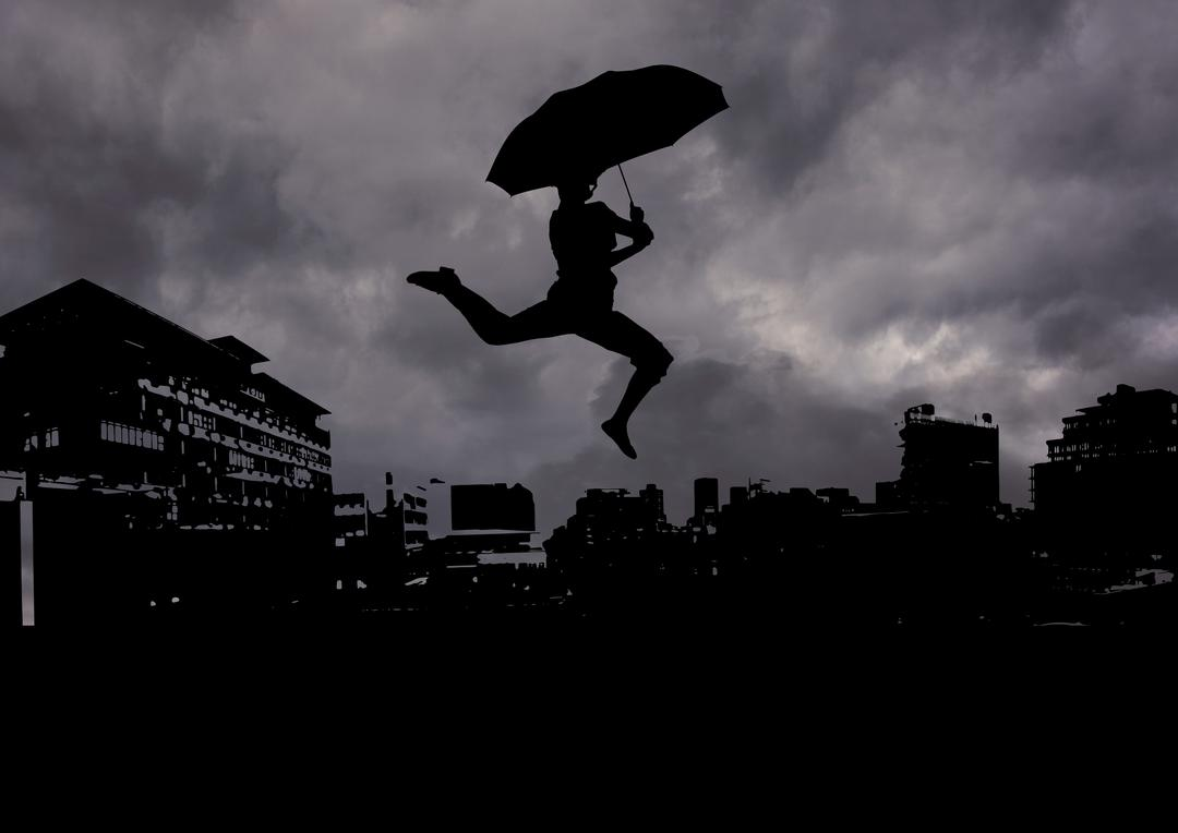 Silhouette of man holding an umbrella against cityscape