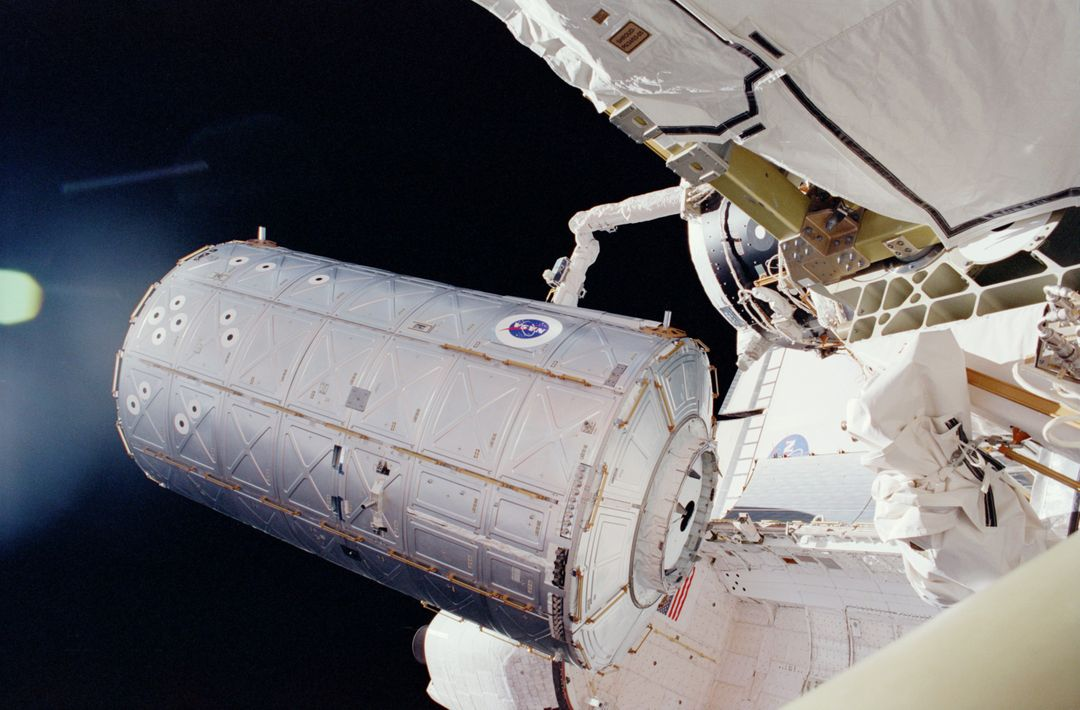 STS098-331-0017 (7-20 February 2001) ---  In the grasp of the shuttle's remote manipulator system (RMS) robot arm, the Destiny laboratory is moved from its stowage position in the cargo bay of the Space Shuttle Atlantis.  The photo was taken by astronaut Thomas D. Jones, who was participating in one of three STS-98/5a space walks at the time. Astronaut Robert L. Curbeam (out of frame) also made the three space walks.