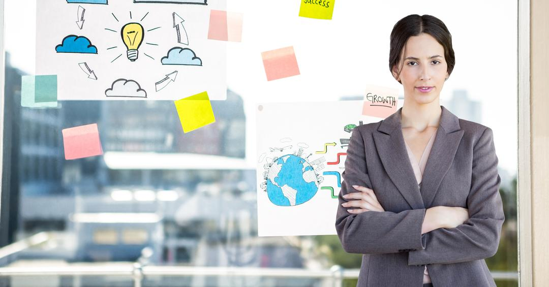 Digital composition of businesswoman standing with arms crossed against sticky notes in background