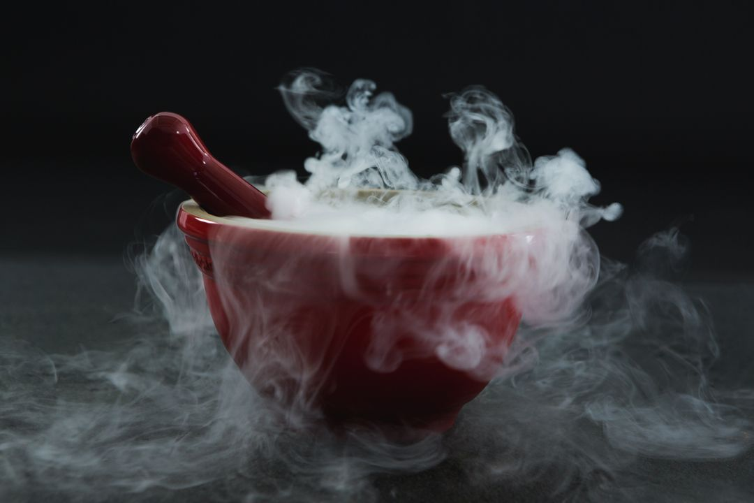 Close-up of dry ice smoke in bowl on black background Free Stock Images from PikWizard