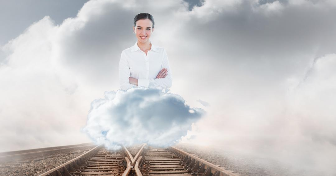 Digital composite of Digitally generated image of businesswoman on railroad track against cloudy sky