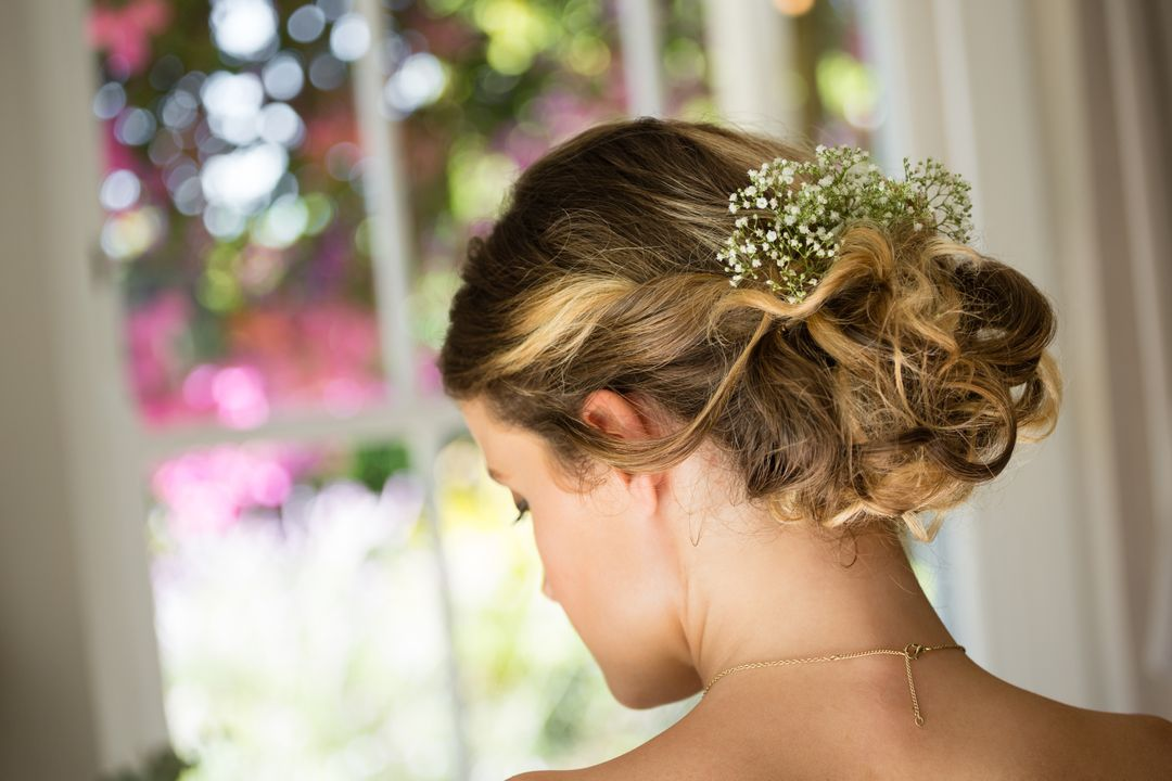 Fashion photo of a bride with her hair styled in a bun