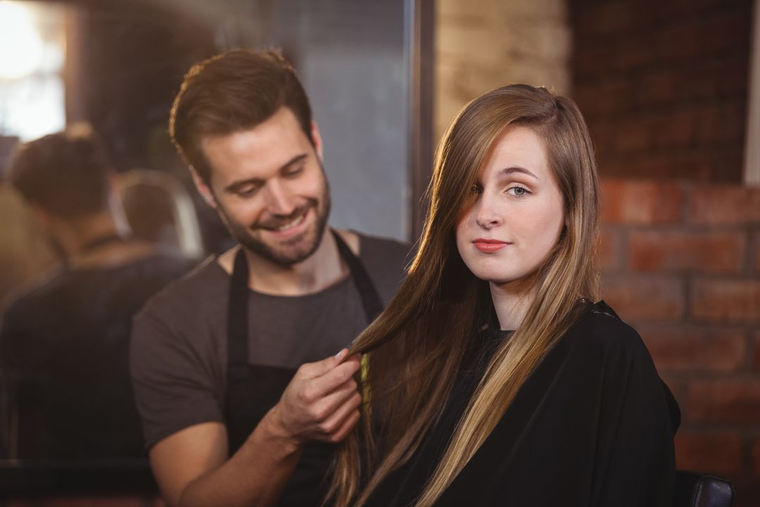 Handsome hair stylist with client at the hair salon Free Stock Images from PikWizard