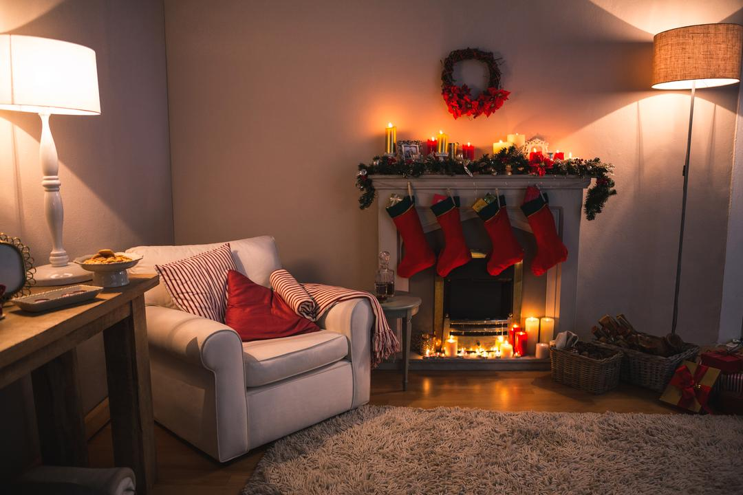 Fireplace decorate with christmas decor and ornaments in living room at home