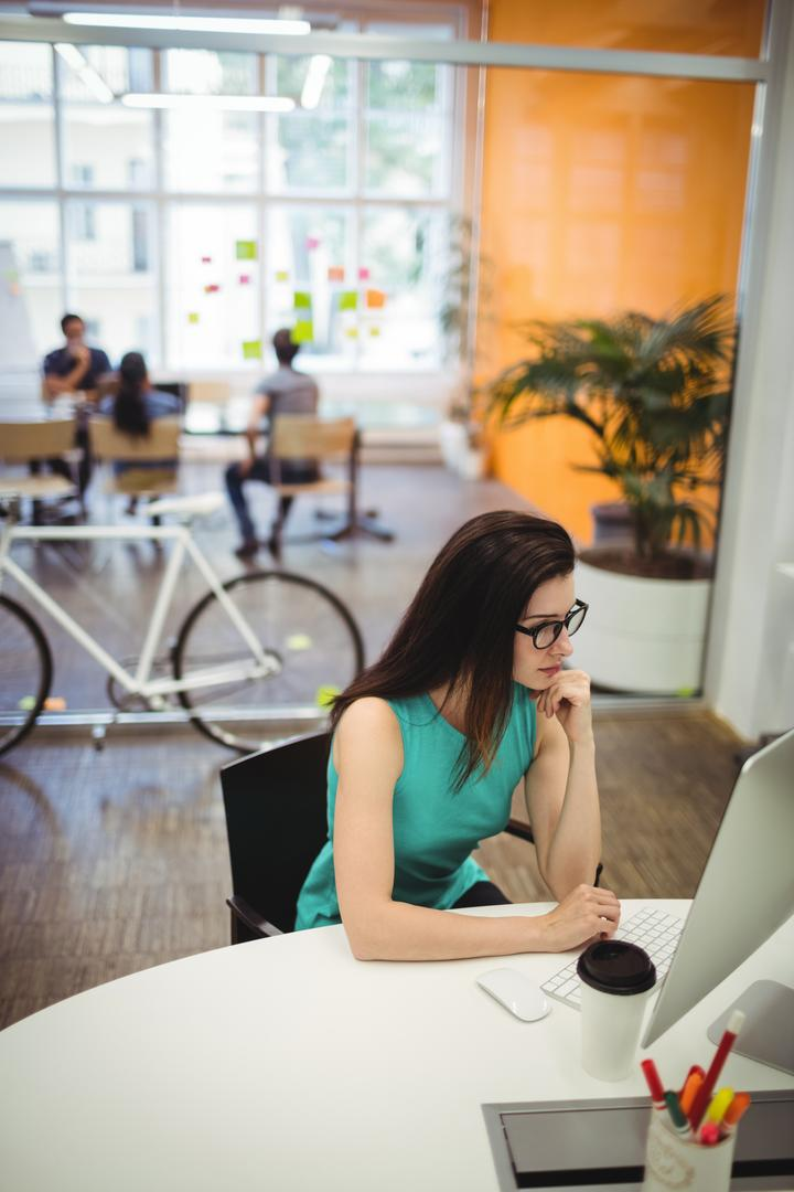 Beautiful female executive working at her desk in office