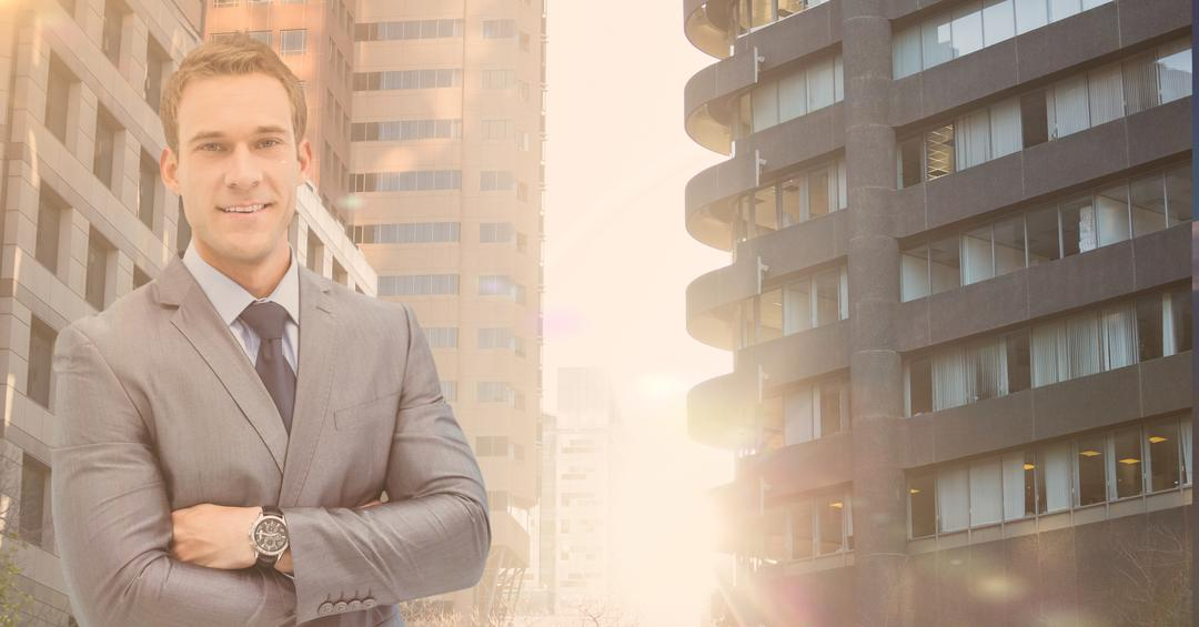 Digital composition of a confident businessman standing with arms crossed with buildings in background