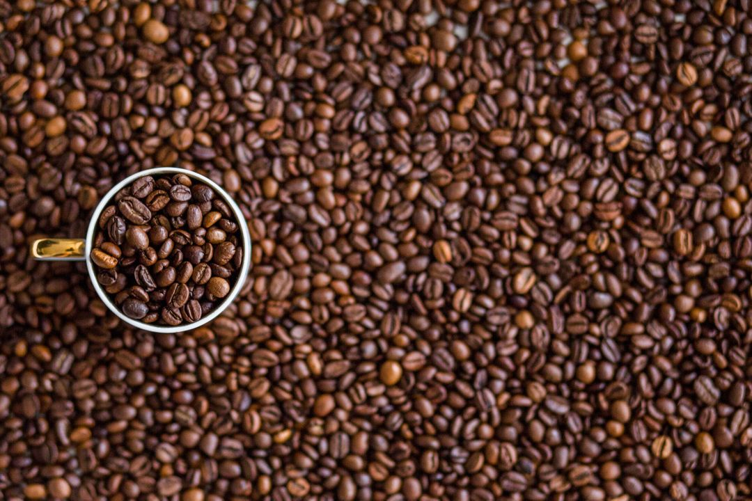 Coffee Cup Full of Beans Free Photo