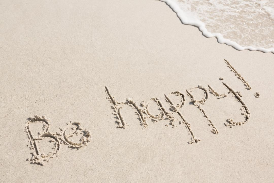 Be happy written on sand at beach