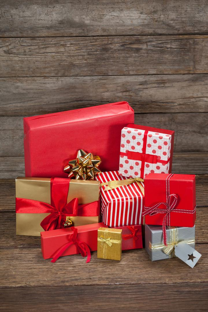 Various wrapped gift box on wooden table during christmas time Free Stock Images from PikWizard