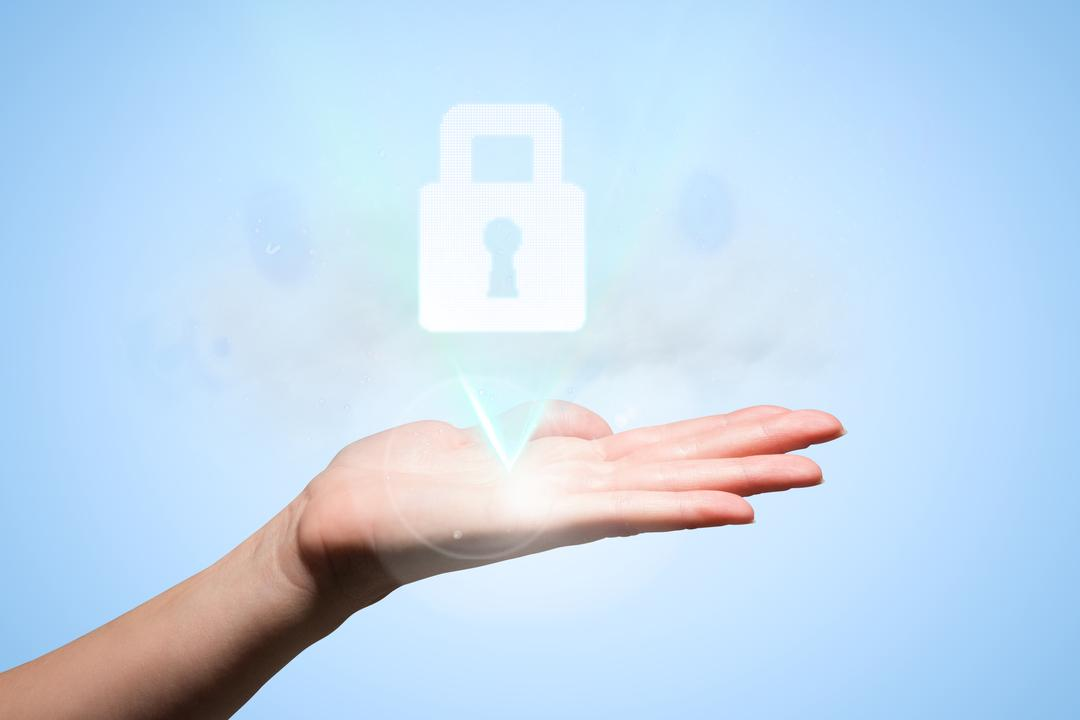 Composite of hand holding padlock graphic over blue background Free Stock Images from PikWizard