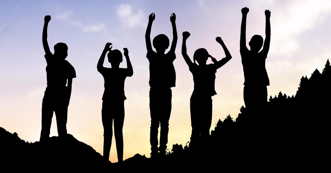 Digital composite of Silhouette children with arms raised standing on hill