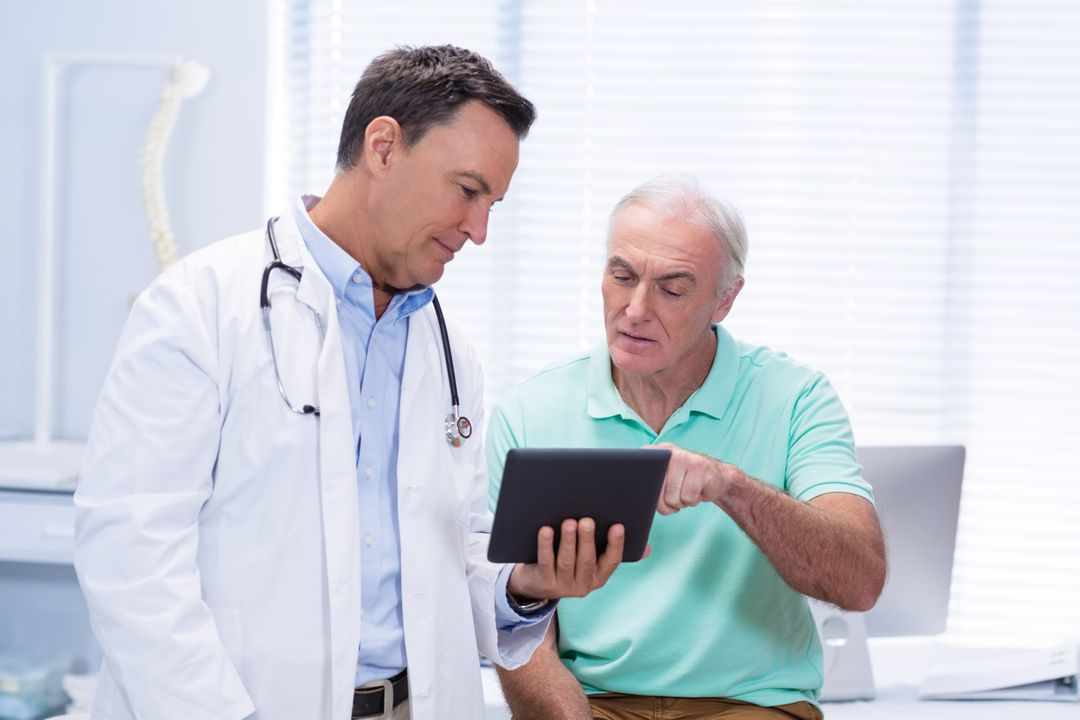 Doctor and senior patient using digital tablet in clinic Free Stock Images from PikWizard