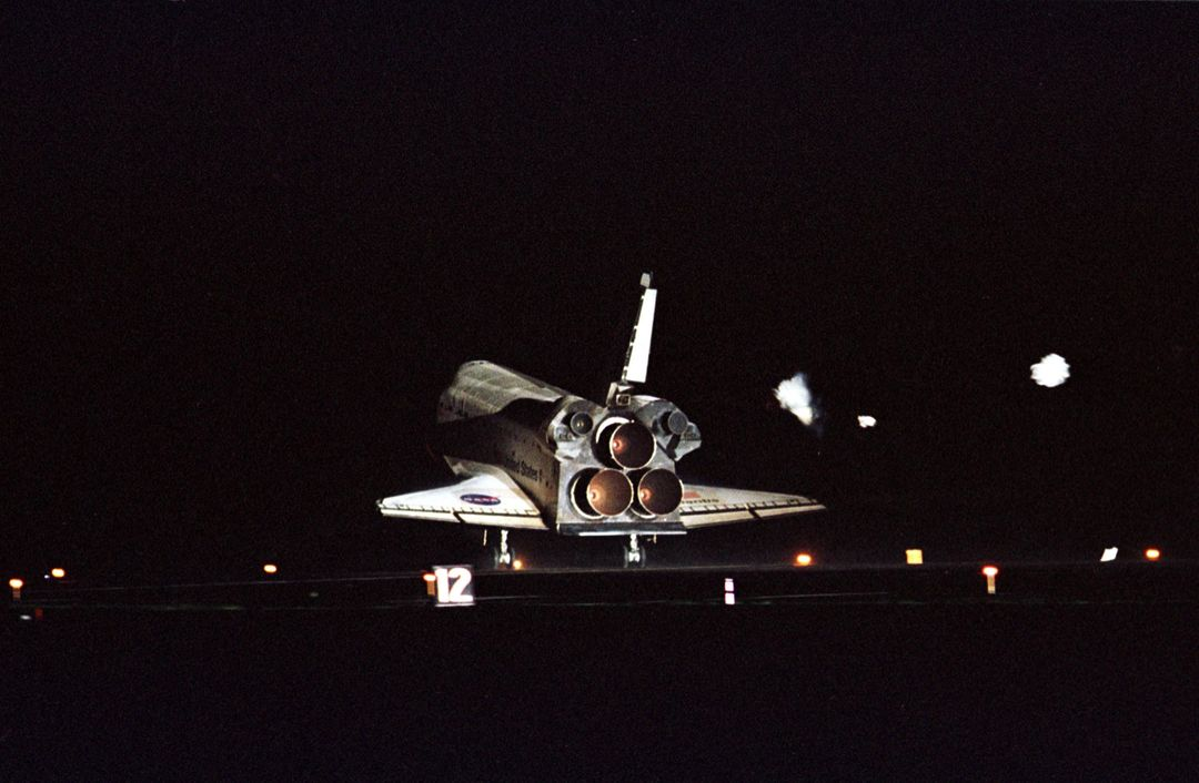 KENNEDY SPACE CENTER, Fla. -- The lights on Runway 15 at KSC's Shuttle Landing Facility spotlight Atlantis as it touches down, completing a 12-day, 18-hour, 34-minute-long STS-104 mission. Main gear touchdown occurred at 11:38:55 p.m. EDT. At the controls is Commander Steven W. Lindsey. Other crew members on board are Pilot Charles Hobaugh and Mission Specialists Michael Gernhardt, Janet Lynn Kavandi and James F. Reilly. This is the 18th nighttime landing for a Space Shuttle, the 13th at Kennedy Space Center. The mission delivered the Joint Airlock Module to the International Space Station, which was subsequently attached to the Unity Node, completing the second phase of the assembly of the Space Station