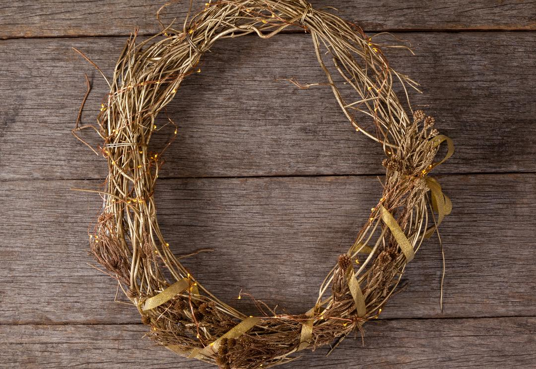 Wreath with golden ornament on a plank Free Stock Images from PikWizard