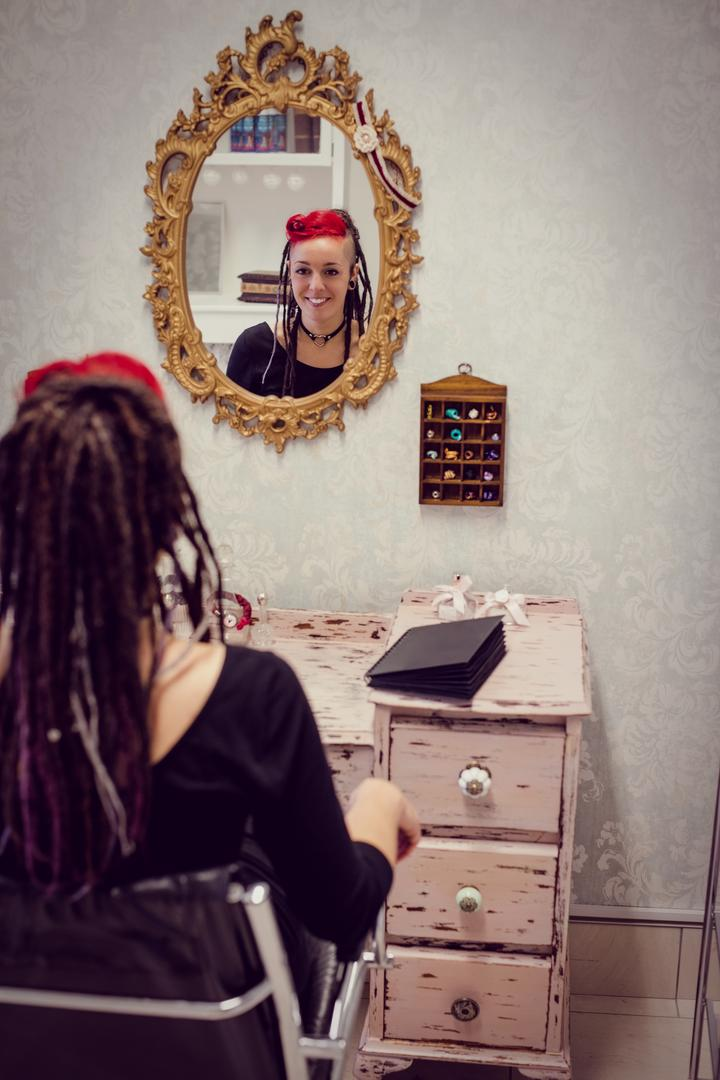 Female hairdresser sitting in dreadlocks shop Free Stock Images from PikWizard