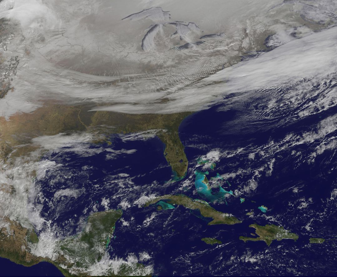 "NOAA's GOES-East satellite provided a look at the frigid eastern two-thirds of the U.S. On Jan. 7, 2015, that shows a blanket of northern snow, lake-effect snow from the Great Lakes and clouds behind the Arctic cold front.   A visible picture captured at 1600 UTC (11 a.m. EST) showed the effects of the latest Arctic outbreak. The cold front that brought the Arctic air has moved as far south as Florida, and stretches back over the Gulf of Mexico and just west of Texas today. The image shows clouds behind the frontal boundary stretching from the Carolinas west over the Heartland. Farther north, a wide band of fallen snow covers the ground from New England west to Montana, with rivers appearing like veins. The GOES-East satellite image also shows wind-whipped lake-effect snows off the Great Lakes, blowing to the southeast. Meanwhile, Florida, the nation's warm spot appeared almost cloud-free.   To create the image, NASA/NOAA's GOES Project used cloud data from NOAA's GOES-East satellite and overlaid it on a true-color image of land and ocean created by data from the Moderate Resolution Imaging Spectroradiometer, or MODIS, instrument that flies aboard NASA's Aqua and Terra satellites. Together, those data created the entire picture of the Arctic outbreak.     The forecast from NOAA's National Weather Service Weather Prediction Center (WPC) calls for more snow along the Appalachian Mountains from Tennessee north to upstate New York. Snow is also expected to fall from New England west to Montana, and in eastern New Mexico and the Colorado Rockies. The WPC summary for Jan. 7 noted: Bitter cold will be felt from the western High Plains to the Mid-Atlantic and Northeast U.S. For the next few days. Widespread subzero overnight lows are forecast for the Dakotas, Upper Midwest, Great Lakes, and interior New England. Wind Chill Advisories and Warnings are in effect for many of these areas.   GOES-East provides visible and infrared images over the eastern U.S. And the Atlantic Ocean from its fixed orbit in space. NOAA's GOES satellites provide the kind of continuous monitoring necessary for intensive data analysis. Geostationary describes an orbit in which a satellite is always in the same position with respect to the rotating Earth. This allows GOES to hover continuously over one position on Earth's surface, appearing stationary. As a result, GOES provide a constant vigil for the atmospheric triggers for severe weather conditions such as tornadoes, flash floods, hail storms and hurricanes.   For updated information about the storm system, visit NOAA's NWS website:   <a href=""http://www.weather.gov"" rel=""nofollow"">www.weather.gov</a>   For more information about GOES satellites, visit: <a href=""http://www.goes.noaa.gov/"" rel=""nofollow"">www.goes.noaa.gov/</a> or goes.gsfc.nasa.gov/   Rob Gutro NASA's Goddard Space Flight Center, Greenbelt, Md.  <b><a href=""http://www.nasa.gov/audience/formedia/features/MP_Photo_Guidelines.html"" rel=""nofollow"">NASA image use policy.</a></b>  <b><a href=""http://www.nasa.gov/centers/goddard/home/index.html"" rel=""nofollow"">NASA Goddard Space Flight Center</a></b> enables NASA's mission through four scientific endeavors: Earth Science, Heliophysics, Solar System Exploration, and Astrophysics. Goddard plays a leading role in NASA's accomplishments by contributing compelling scientific knowledge to advance the Agency's mission. <b>Follow us on <a href=""http://twitter.com/NASAGoddardPix"" rel=""nofollow"">Twitter</a></b> <b>Like us on <a href=""http://www.facebook.com/pages/Greenbelt-MD/NASA-Goddard/395013845897?ref=tsd"" rel=""nofollow"">Facebook</a></b> <b>Find us on <a href=""http://instagram.com/nasagoddard?vm=grid"" rel=""nofollow"">Instagram</a></b>"