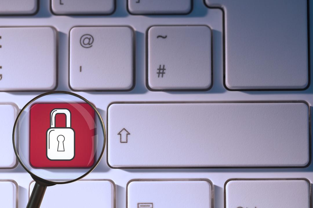 Composite of padlock symbol on keyboard with magnifying glass Free Stock Images from PikWizard