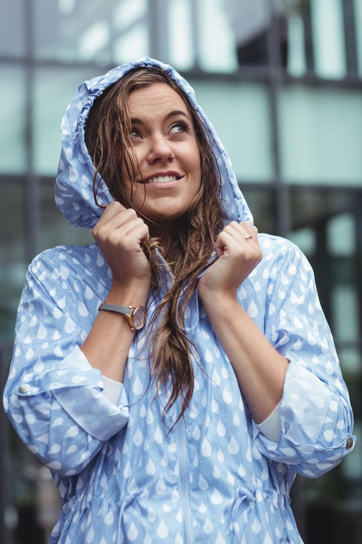 Thoughtful beautiful woman wearing windcheater during rainy season Free Stock Images from PikWizard