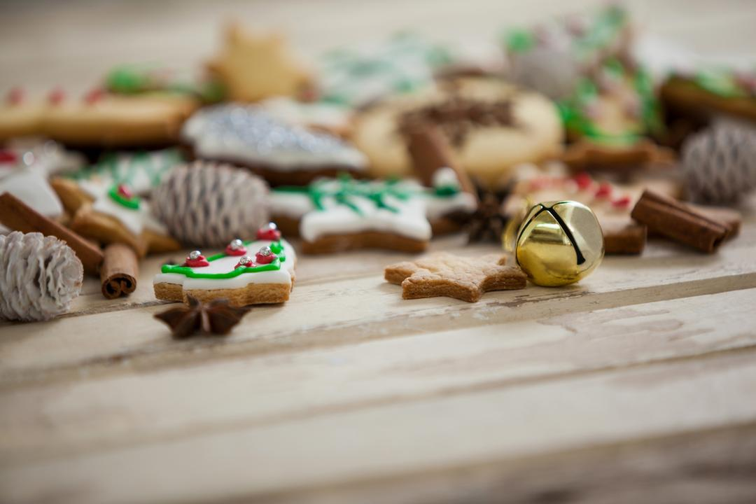 Christmas cookies with jingle bell on a plank