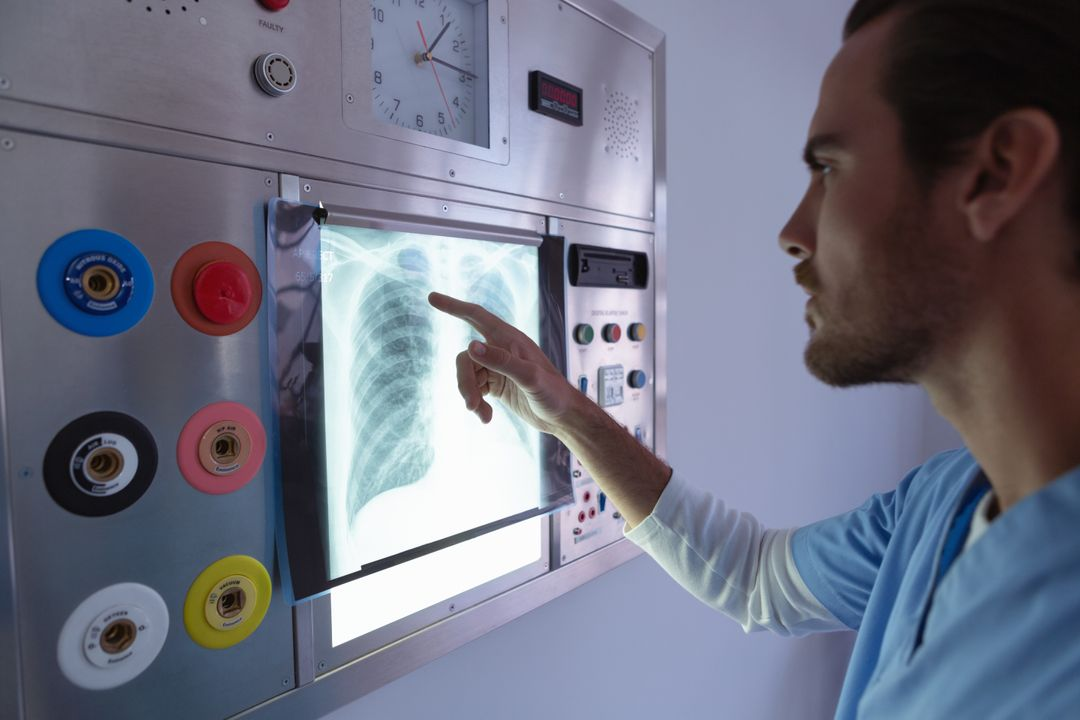 Side view of male surgeon examining x-ray on x-ray light box in operation room at hospital Free Stock Images from PikWizard